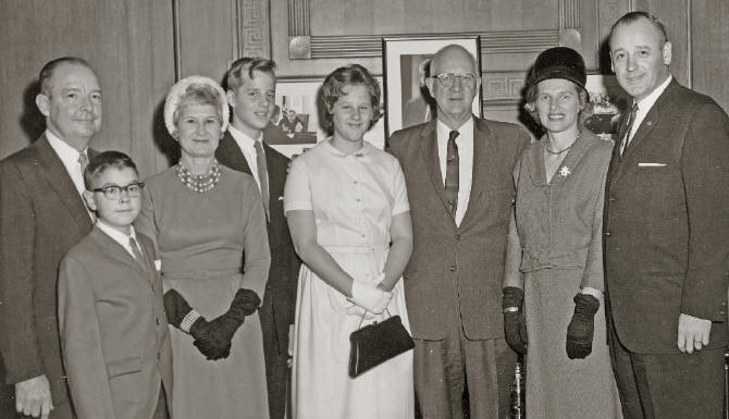 Left to right: A. Clark and Alma Stratton with their son; George Hartzog, III, Nancy Hartzog, Conrad L.Wirth, and Helen and George B. Hartzog, Jr., at Hartzog's swearing in ceremony, 1964. (National Park Service Historic Photograph Collection, Harpers Ferry Center.)