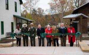 Officials cut a red ribbon to open Boston Mill Visitor Center